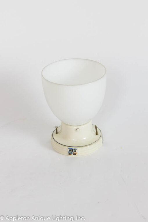 Porcelain flush mount fixture with milk glass
