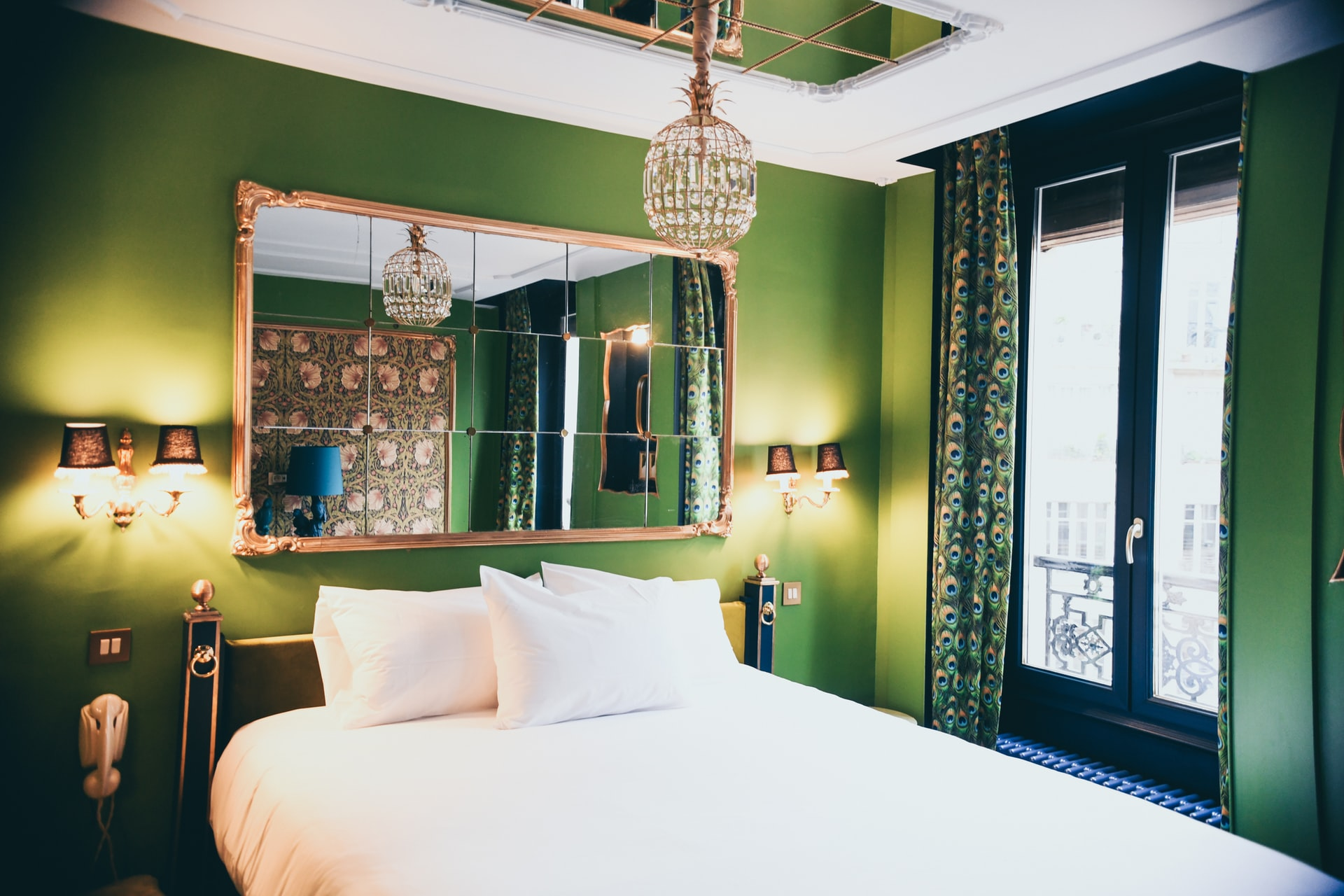 how to pick bedroom lighting: Green Bedroom with Crystal pendant and a pair or sconces.